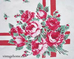 detail of a vintage cotton printed tablecloth, lovely pink/red roses