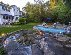 Waterfall flows into spa and pond . . . http://www.paradiserestored.com/portfolio/day-property/