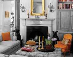 Room of the Day ~ soft gray and yummy orange in this elegant but fun room - love the black pooches - design by Florence de Dampierre