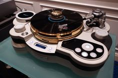 TechDas Air Force One Special Edition turntable With a Graham Phantom III Elite tonearm The new features: Gold-plated main Stainless turntable and Gold-plated titanium upper platter. TDC01Ti special specification: Gold-plated Cover, Disc Stabilizer, Gold-plated Knob.
