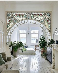 stained glass arch in interior designer anouk Taeymans' Art Nouveau apartmen. - Inspirational Interior Design Ideas for Living Room Design, Bedroom Design, Kitchen Design and the entire home. Decor, House Inspiration, House Styles, House Design, Interior, I Like Lamp, Beautiful Homes, Home Decor, House Interior