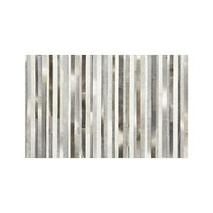 Fonda Grey Striped Cowhide Rug | Crate and Barrel  Assorted Sizes high-fashion rug pieces together luxe leather strips in a patchwork of rich greys with coordinating stitching detail. Constructed with felted backing for stability and a soft feel underfoot,