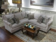 Light gray sectional with darker grays and soft blue accents