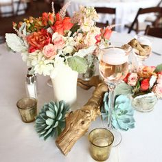 A beautiful wedding with driftwood and succulent centerpieces.