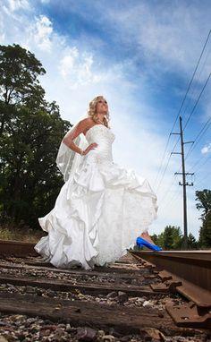 Bride shows bright blue heels on train tracks | Matt Mason Photography | Lake Geneva, WI