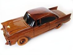 A favorite classic car of the the 1957 Chevy Belair brings back the days of drive-in movies, car hops and cruising Main. This handcrafted mahogany scale model has a high gloss finish and deep wood grain. Wooden Toy Cars, Wood Toys, Wooden Gifts, Military Car, Art Plastique, Wood Design, Toys For Boys, Wood Art, Wood Crafts