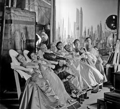 June Allyson, Joan Collins, Joan Blondell, Agnes Moorehead.  Studios used special stand-up chairs so actresses could relax but not wrinkle their gowns between takes.