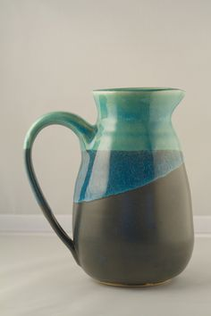 This piece is very simple, and I like that. I hope to make a pitcher like this with a simple color scheme as well.