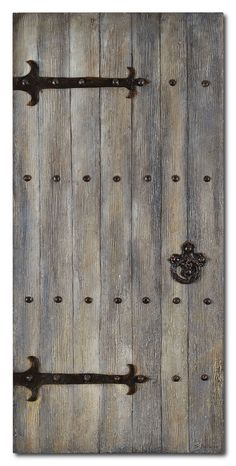 Bring the old world into the now with this medieval-inspired decor. A wood panel door is accented with an antique-style metal handle, hinges and bolts for a truly beautiful piece. The wood's natural tone creates a rustic feel while metal decorations offer an industrial feel. Whether you want to enhance your current rustic-industrial decor or add a statement piece amongst your modern style, this work of art from Stephane Fontaine will make a stunning mark in your home.