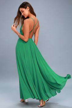 The Mythical Kind of Love Green Maxi Dress is simply irresistible in every single way! A billowing maxi dress with apron neckline, crisscrossing straps and an open back.