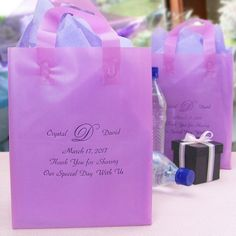 Order personalized 8 x 5 x 10 semi-transparent frosted poly wedding gift bags with handles for your out of town guests and as hotel welcome bags.
