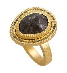 Raw diamond set in hand-forged 18kt gold ring by Todd Reed