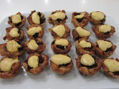 Mini cinnamon-brandied blackberry bread pudding with sabayon sauce