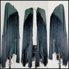 1920s witchy cape w/ ridiculously long fringe + even longer fringe tassels.