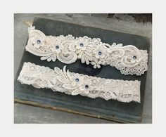 """Ivory stretch lace """"something blue"""" garter with venice lace accented with blue swarovski crystals."""
