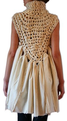 The garment was embellished by crocheting muslin strips to create the back and collar of the shirt