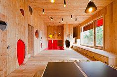 Josef-Felder-Strasse Kindergarten designed by Hiendl Schineis Architekten in Germany. Built-in scaled furniture, playful lights and wall penetrations.