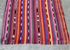 Bright Ethnic Guatemalan Fabric sold by yard * Handmade Ikat Fabric from Guatemala  1 yard of 100% cotton fabric hand woven in Guatemala. Beautiful rainbow color combination. Comes from smoke and pet free home.  Weight aprox.: 5oz/yd2 Width: 36 / 90cm Sold by yard.   FREE SAMPLES are NOT available. No half yards.  BULK orders are possible, starting at 20 yards. It is possible to combine the 20 yards. Sold by yard. In case the customer buy more than one yard, we will provide them as ...