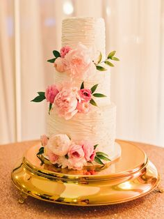 Round Textured Buttercream Wedding Cake With Blush Flowers | Photo: Amy Arrington Photography | Cake: LuLu's Oven |
