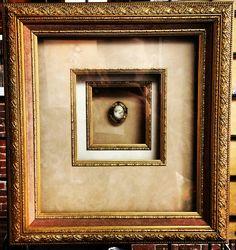 Custom framed brooch using 2 suede mats, 1 rag mat, 3 fillets, a linen liner, and Larson-Juhl's Imperial frame