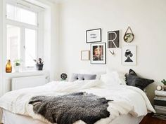Or just frame your favorite prints: | Community Post: 19 Ways To Make Your Bed Work Without A Headboard