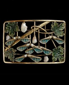 An Art Nouveau gold, enamel and pearl choker plaque, unknown maker, circa 1900. Of convex rectangular form, the frame enclosing an arrangement of a diagonal branch, 4 sycamore leaves, 5 winged sycamore seed pods on vertical stems, and four baroque pearls mounted on vertical stems; pairs of smaller pearls set in each of the winged seed pods. 5 x 7.3cm.