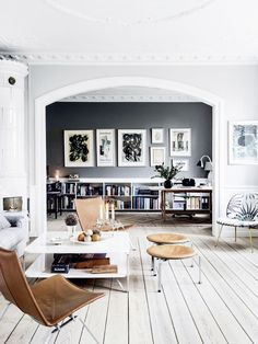 Black feature wall - Inside the Gorgeous Gray Home of a Danish Interior Stylist via @MyDomaine