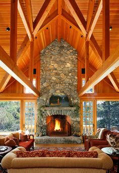 The slab of rock for a hearth and the real fieldstone, love the rustic look.