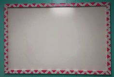 DIY 4'x3' White board and frame. white board from lowes $10.00. frame parts, paint, and painters tape $15.00.