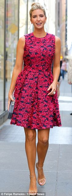 Pretty in pink: The mini dress featured a floral design as she teamed the look with a pair...