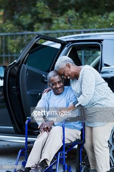 Stock Photo : Disabled senior man in wheelchair with his devoted wife