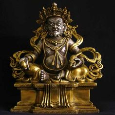 Jambhala or Kubera, the preserver of wealth. Sterling silver with gold.