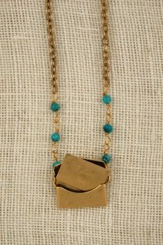"""Envelope locket with """"I Love You"""" letter by Exvoto Vintage jewelry.  #vintagejewelry #turquoise #locket"""