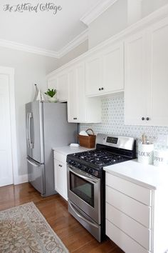 So fresh and pretty!  The Lettered Cottage Kitchen   Cabinets are Simply White   Walls are Gray Owl lightened by 50 percent   Backsplash from Caledonia Stone