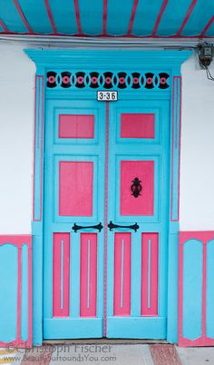 A typical brightly painted front door of a house in Salento, Quindio, Colombia