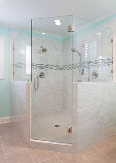 """This relatively small master bathroom is only 100 square feet and yet there is eye-catching detail in every corner! Having multiple windows and lights colors used throughout makes this space feel larger than it really is! The white porcelain tile gives that """"marble look"""" without breaking the bank, the fun accent tile give this space character with hidden over-sized shower niche, the vanity maximizes storage with an end tower while still accommodating a his/her vanity. Corner Shower Stalls, Window In Shower, Shower Niche, Master Shower, Shower Doors, Master Bathroom, Bathroom Renos, Bathroom Layout, Bathroom Ideas"""