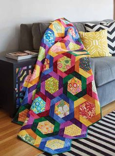 Twirling Hexies. This is one of our favorite scrap quilt patterns! Need a great quilt pattern for using up those medium and large-scale prints you have been saving? Try Nancy Mahoney's quilt design using hexagons and half hexagons.
