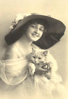 Idk who she is but I love this picture, happy girl, fabulous hat, fluffy cat