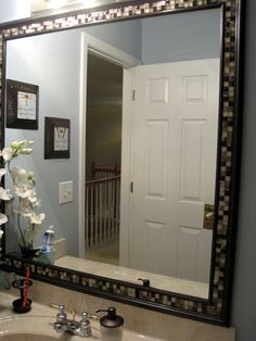 Bathroom Mirror Edge Trim framing mirror using crown molding and spray paint so much