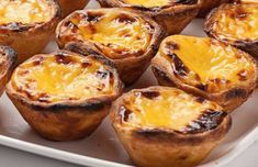Portuguese custard tarts are well known around the world for their crispy pastry and heavenly delicious filling. Info Preparation time: 15 min Cooking Time: 40 min Ready In: 55 min Level of Difficulty: Easy Servings: 8 Portuguese Custard Tart Recipe, Portuguese Tarts, Portuguese Recipes, Portuguese Desserts, Portuguese Food, Portuguese Culture, Tart Recipes, New Recipes, Cooking Recipes