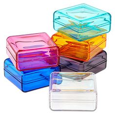 Our Square Boxes are just as beautiful as they are functional. They're made of sturdy acrylic in beautiful jewel tones as well as a crystal clear color, and are perfect to store small objects or treats during special occasions and beyond. They're easy to see through and their beautiful shape adds a touch of style no matter where they're housed.