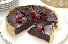 Chocolate and raspberry tart Melt-in-the-mouth chocolate, juicy raspberries and sweet crumbly pastry team up in this super-indulgent dessert
