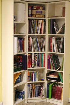 Think that I like this method of dealing with corners and bookcases best as appears like less loss of space