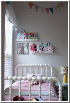 Pretty little girl's room with lots of personalised items...