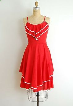 Cherry Ribbons Dress, Adorable vintage 1970s red summer sundress with adorable white pipe trim on ruffled bib and tiered skirt. Waist is loose (pinned to fit) but would look darling belted. from ADOREVINTAGE [$54.40]