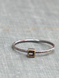 oxidized tiny brass cube ring. $22.00, via Etsy.