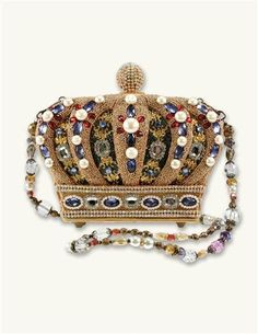 This is the Queendom Handbag by Mary Frances. Thousands of hand-laid beads and crystal-like components create a decadent gold crown design featuring hints of red and purple. The removable beaded shoulder strap can also be worn as a necklace. Bridal Handbags, New Handbags, Handbags On Sale, Luxury Handbags, Purses And Handbags, Unique Handbags, Brown Handbags, Unique Bags, Mary Frances Purses