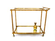 FOR DINING ROOM???     Vintage Hollywood Regency Faux Bamboo Bar Cart | Mid Century Italian Gold Gilt Two-Tier Cocktail Cart | Chinoiserie Chic Portable Server by ELECTRICmarigold on Etsy https://www.etsy.com/listing/501418029/vintage-hollywood-regency-faux-bamboo