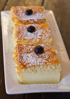 Magic Cake Recipe ~ make the batter, pour the batter in a 8 inch x 8 inch baking dish, place it in the oven and let the magic happen. After an hour you have a perfect 3 layer cake with the most delicious custard layer. This truly is one of the easiest cakes you'll ever make and one of the most impressive and not to mention delicious!