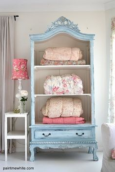 I love this painted blue cabinet. And think the door removal is genius...it becomes a shelving unit. Great idea...especially if you find a cabinet at a flea market with a busted door.